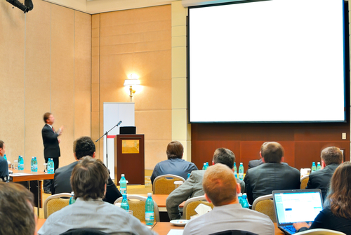 Meeting, conference, presentation in aditorium with blank screen