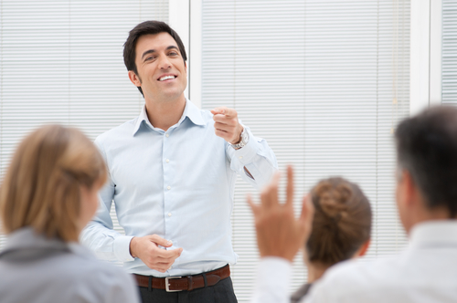 Business consultant answering a question during a meeting at office